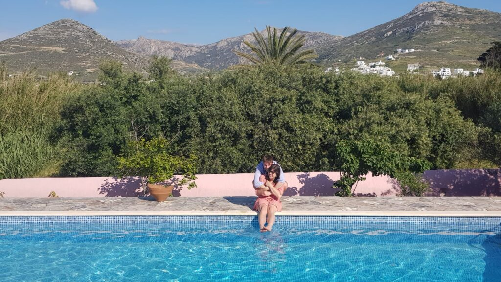 engaged couple by the pool