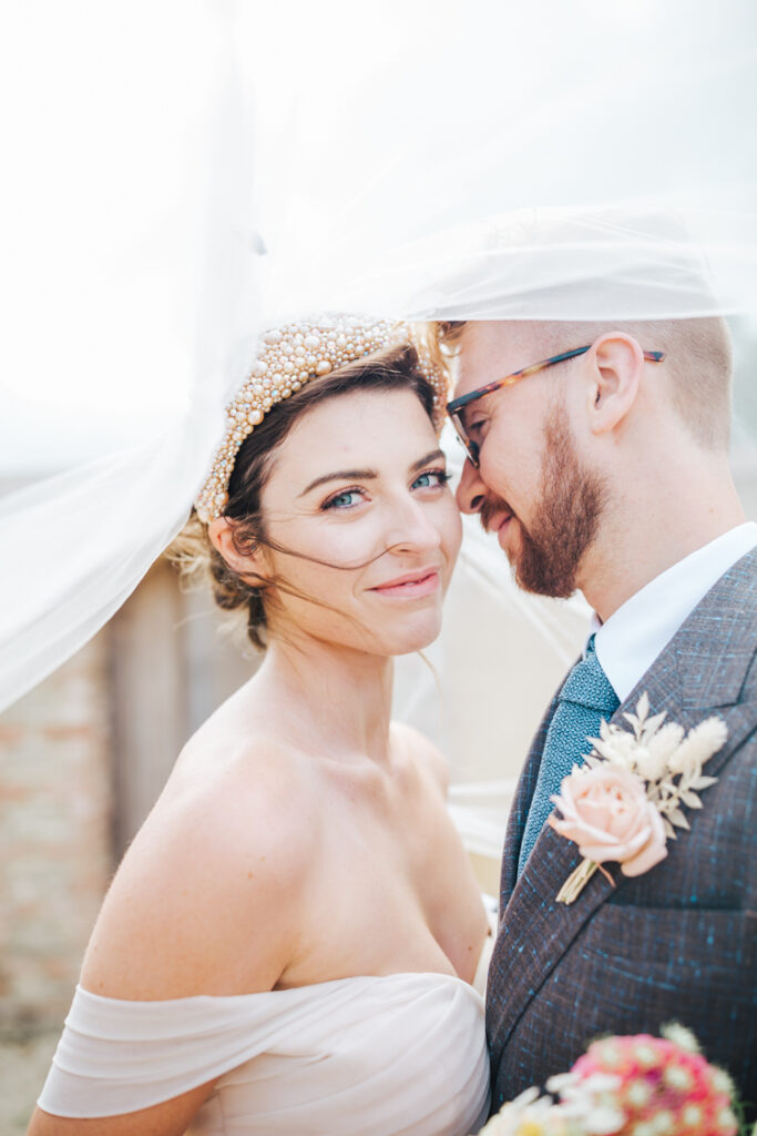 Kelly Faetanini bridalwear and headband supplied exclusively by Ellie Sanderson.