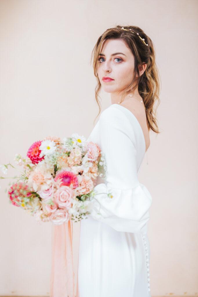 Suzanne Neville wedding gown stocked Ellie Sanderson bridal boutique.